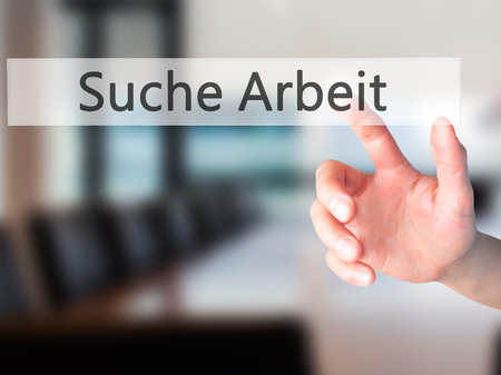 arbeit: Suche Arbeit (Job Search in German) - Hand pressing a button on blurred background concept . Business, technology, internet concept. Stock Photo