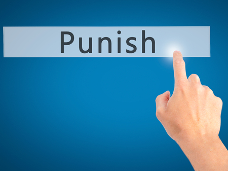 fining: Punish - Hand pressing a button on blurred background concept . Business, technology, internet concept. Stock Photo Stock Photo