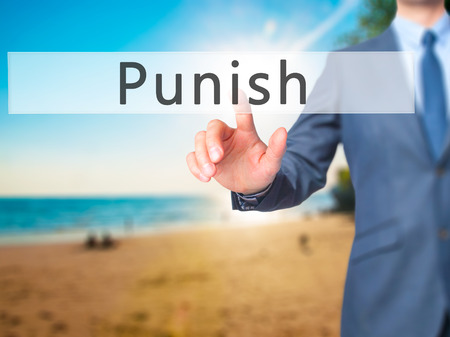 fined: Punish - Businessman hand pressing button on touch screen interface. Business, technology, internet concept. Stock Photo