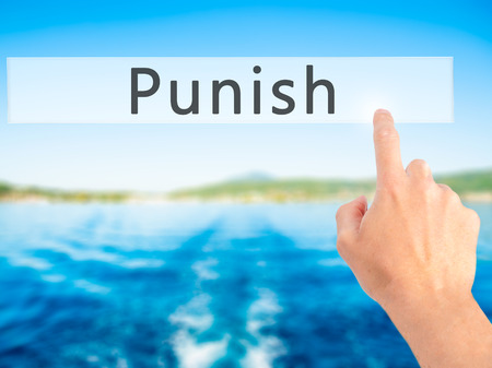 law enforcing: Punish - Hand pressing a button on blurred background concept . Business, technology, internet concept. Stock Photo Stock Photo