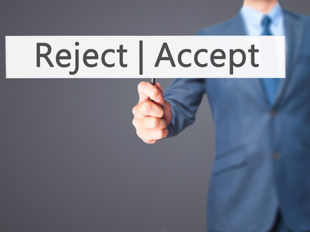 approvement: Accept  Reject - Businessman hand holding sign. Business, technology, internet concept. Stock Photo