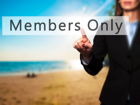 private club: Members Only - Businesswoman hand pressing button on touch screen interface. Business, technology, internet concept. Stock Photo Stock Photo
