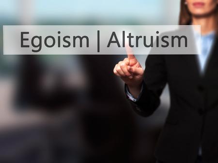 egoist: Altruism  Egoism - Businesswoman hand pressing button on touch screen interface. Business, technology, internet concept. Stock Photo