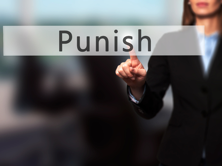 Punish - Businesswoman hand pressing button on touch screen interface. Business, technology, internet concept. Stock Photo