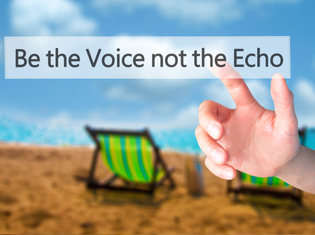 echo: Be the Voice not the Echo - Hand pressing a button on blurred background concept . Business, technology, internet concept. Stock Photo
