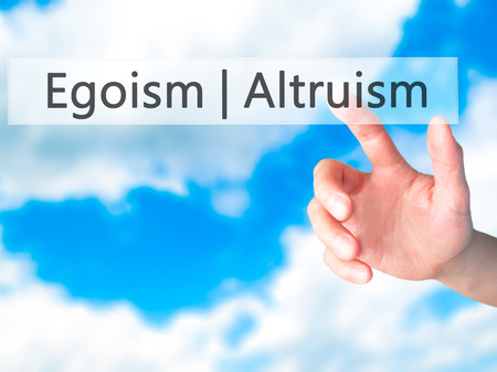 better: Altruism  Egoism - Hand pressing a button on blurred background concept . Business, technology, internet concept. Stock Photo Stock Photo