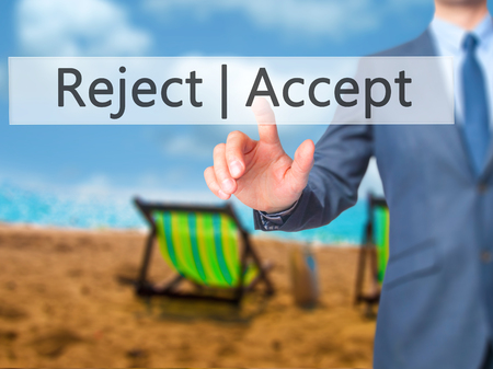 approvement: Accept  Reject - Businessman hand pressing button on touch screen interface. Business, technology, internet concept. Stock Photo Stock Photo