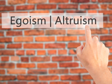 selfless: Altruism  Egoism - Hand pressing a button on blurred background concept . Business, technology, internet concept. Stock Photo Stock Photo