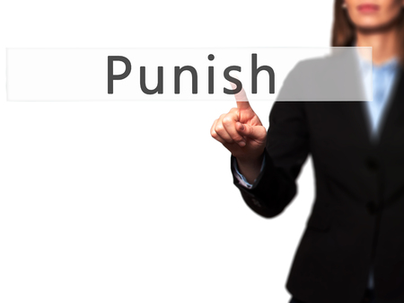fined: Punish - Businesswoman hand pressing button on touch screen interface. Business, technology, internet concept. Stock Photo
