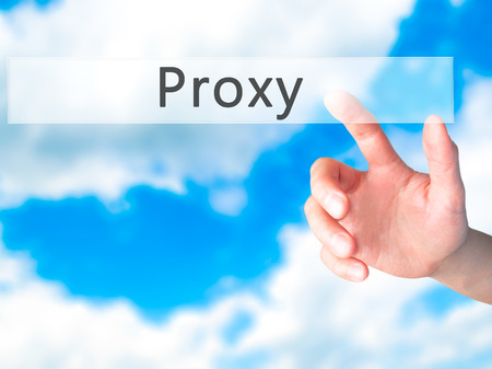 proxy: Proxy - Hand pressing a button on blurred background concept . Business, technology, internet concept. Stock Photo