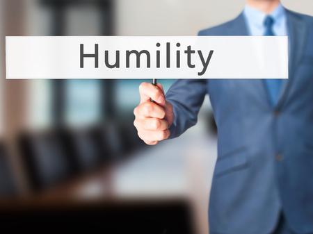 soltería: Humildad - La mano de negocios la celebración de firmar. Negocios, la tecnología, el concepto de internet. Foto de stock Foto de archivo