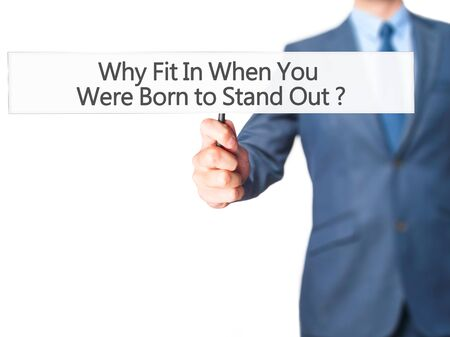 differentiation: Why Fit In When You Were Born to Stand Out - Businessman hand holding sign. Business, technology, internet concept. Stock Photo