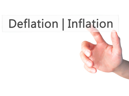 deflation: Deflation Inflation - Hand pressing a button on blurred background concept . Business, technology, internet concept. Stock Photo