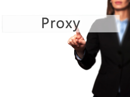 public address: Proxy - Businesswoman hand pressing button on touch screen interface. Business, technology, internet concept. Stock Photo
