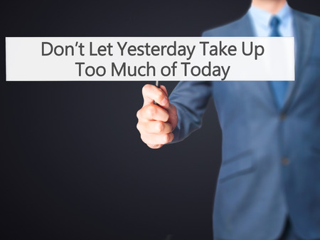 too: Dont Let Yesterday Take Up Too Much of Today - Businessman hand holding sign. Business, technology, internet concept. Stock Photo