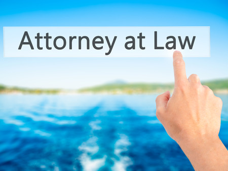 Attorney at Law - Hand pressing a button on blurred background concept . Business, technology, internet concept. Stock Photo
