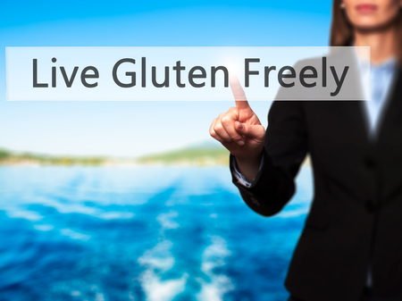 Live Gluten Freely - Businesswoman hand pressing button on touch screen interface. Business, technology, internet concept. Stock Photo