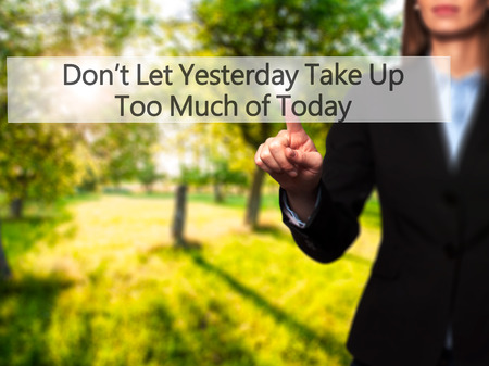 street wise: Dont Let Yesterday Take Up Too Much of Today - Businesswoman hand pressing button on touch screen interface. Business, technology, internet concept. Stock Photo