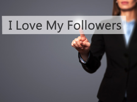 free me: I Love My Followers - Businesswoman hand pressing button on touch screen interface. Business, technology, internet concept. Stock Photo