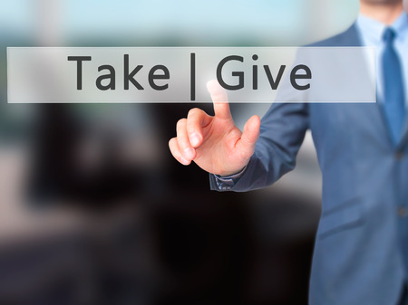 Give  Take - Businessman hand pressing button on touch screen interface. Business, technology, internet concept. Stock Photo Stock Photo