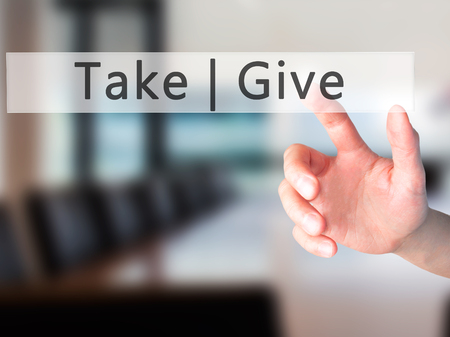 contributors: Give  Take - Hand pressing a button on blurred background concept . Business, technology, internet concept. Stock Photo
