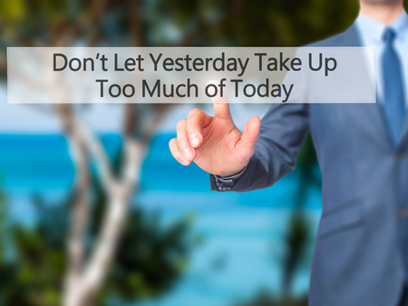street wise: Dont Let Yesterday Take Up Too Much of Today - Businessman hand pressing button on touch screen interface. Business, technology, internet concept. Stock Photo