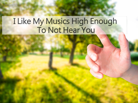 enough: I Like My Musics High Enough To Not Hear You - Hand pressing a button on blurred background concept . Business, technology, internet concept. Stock Photo