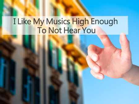 unloved: I Like My Musics High Enough To Not Hear You - Hand pressing a button on blurred background concept . Business, technology, internet concept. Stock Photo