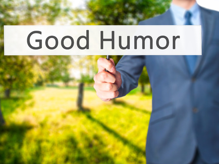 hilarity: Good Humor - Businessman hand holding sign. Business, technology, internet concept. Stock Photo