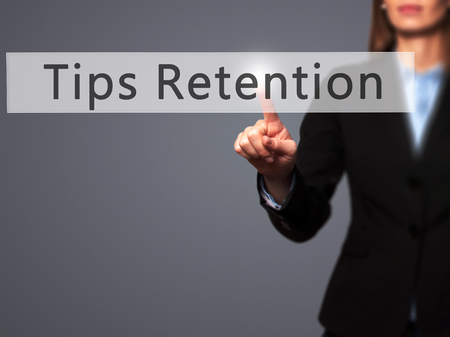 retention: Tips Retention - Businesswoman hand pressing button on touch screen interface. Business, technology, internet concept. Stock Photo
