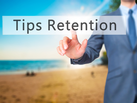 retention: Tips Retention - Businessman hand pressing button on touch screen interface. Business, technology, internet concept. Stock Photo