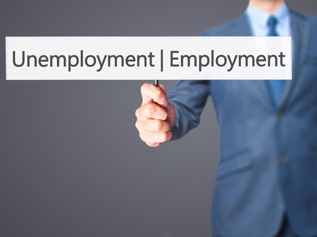 need direction: Employment Unemployment - Businessman hand holding sign. Business, technology, internet concept. Stock Photo