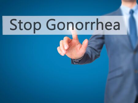 red condom: Stop Gonorrhea - Businessman hand pressing button on touch screen interface. Business, technology, internet concept. Stock Photo Stock Photo