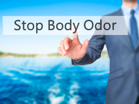 halitosis: Stop Body Odor - Businessman hand pressing button on touch screen interface. Business, technology, internet concept. Stock Photo