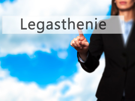 dyslexic: Legasthenie (Dyslexia in German) - Businesswoman hand pressing button on touch screen interface. Business, technology, internet concept. Stock Photo
