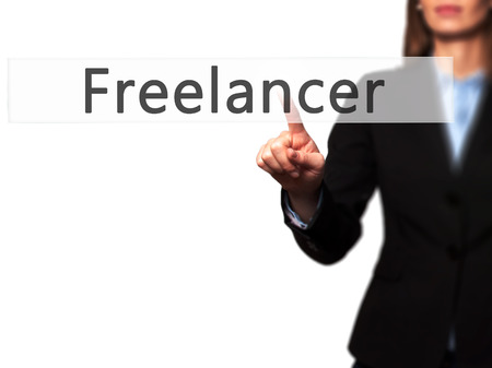 freelancer: Freelancer - Businesswoman hand pressing button on touch screen interface. Business, technology, internet concept. Stock Photo