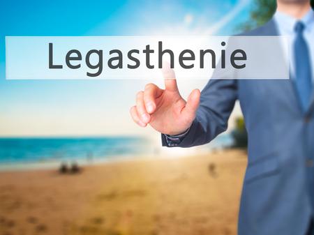 dyslexia: Legasthenie (Dyslexia in German) - Businessman hand pressing button on touch screen interface. Business, technology, internet concept. Stock Photo