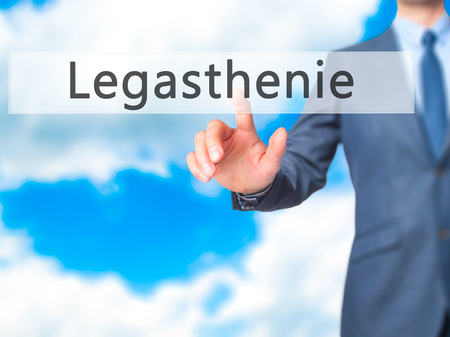 dyslexic: Legasthenie (Dyslexia in German) - Businessman hand pressing button on touch screen interface. Business, technology, internet concept. Stock Photo
