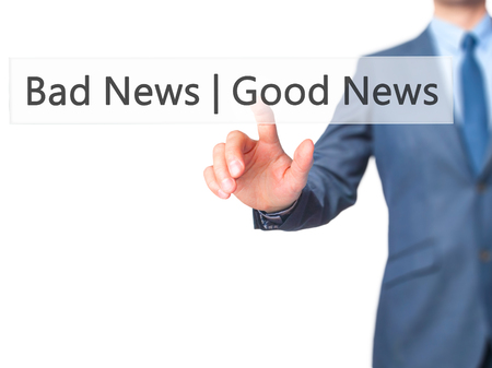 stock news: Good News Bad News - Businessman hand pressing button on touch screen interface. Business, technology, internet concept. Stock Photo Stock Photo