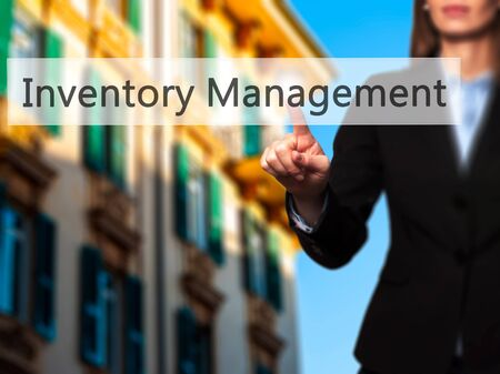 stockroom: Inventory Management - Businesswoman hand pressing button on touch screen interface. Business, technology, internet concept. Stock Photo Stock Photo