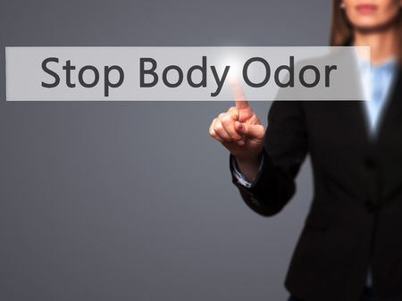 Stop Body Odor - Businesswoman hand pressing button on touch screen interface. Business, technology, internet concept. Stock Photo