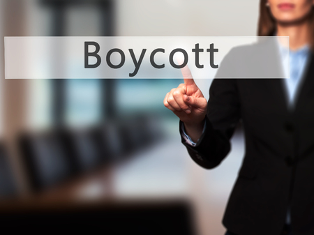 denying: Boycott - Businesswoman hand pressing button on touch screen interface. Business, technology, internet concept. Stock Photo Stock Photo