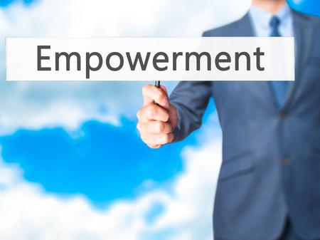 endow: Empowerment - Businessman hand holding sign. Business, technology, internet concept. Stock Photo