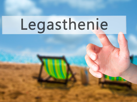 dyslexia: Legasthenie (Dyslexia in German) - Hand pressing a button on blurred background concept . Business, technology, internet concept. Stock Photo