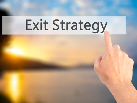 terminate: Exit Strategy - Hand pressing a button on blurred background concept . Business, technology, internet concept. Stock Photo Stock Photo