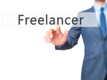 freelancer: Freelancer - Businessman hand pressing button on touch screen interface. Business, technology, internet concept. Stock Photo Stock Photo