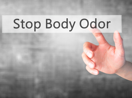 unbearable: Stop Body Odor - Hand pressing a button on blurred background concept . Business, technology, internet concept. Stock Photo Stock Photo