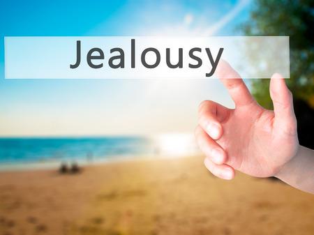 celos: Los celos - Mano presionando un botón en concepto de fondo borroso. Negocios, la tecnología, el concepto de internet. Foto de stock