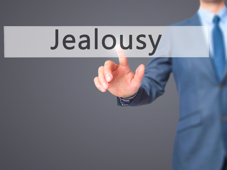 jealousy: Jealousy - Businessman hand pressing button on touch screen interface. Business, technology, internet concept. Stock Photo