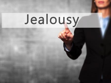 celos: Jealousy - Businesswoman hand pressing button on touch screen interface. Business, technology, internet concept. Stock Photo